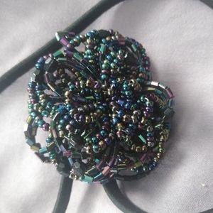 Elastic headband with beaded flower